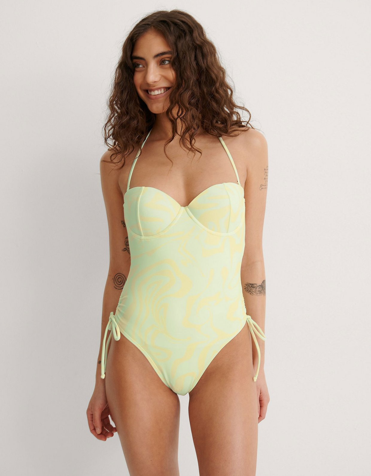 NA-KD Halterneck side straps swimsuit yellow