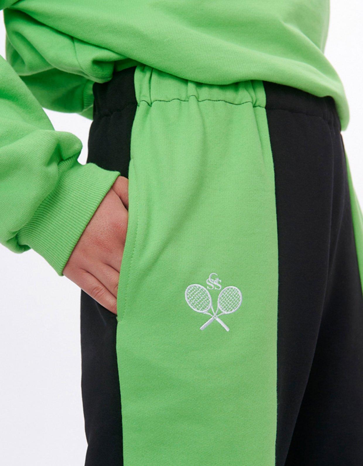 Sunset go Nadine rackets green/black track pants