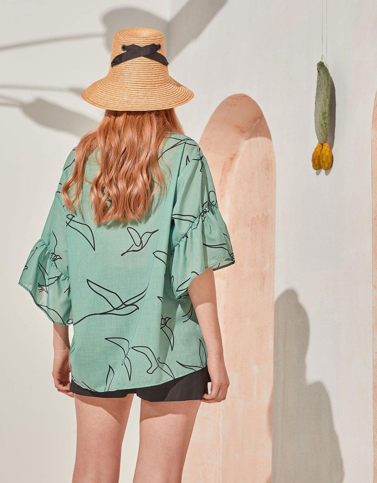 The Knl's Leisure tunic blouse mint birds